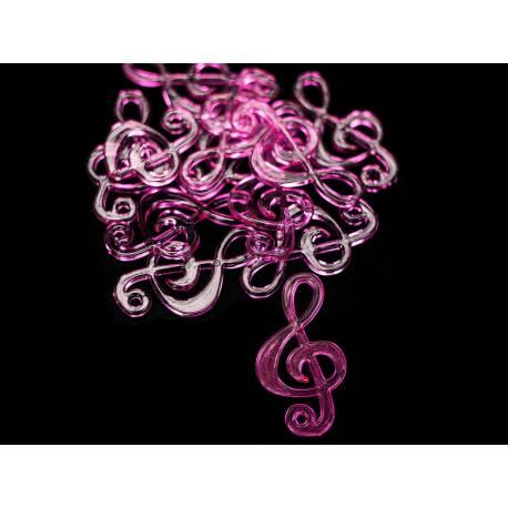 Sachet de 12 clefs de sol en plastique translucide rose Dimensions : 4 cm x 2.3 cm