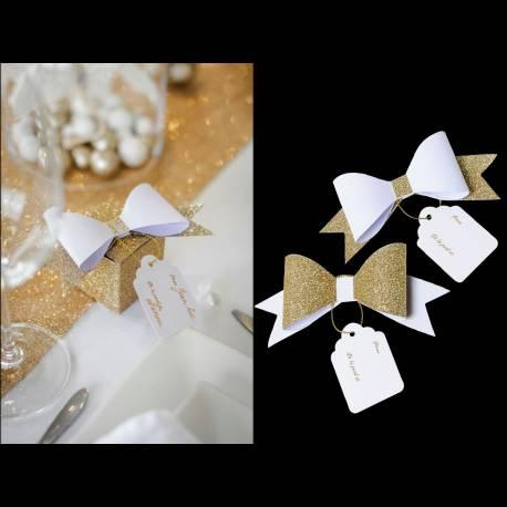 Ces jolis noeuds adhésifs finiront d'habiller vos paquets cadeaux. noeud :13 x 5cm étiquettes : 5.5 cm imprimé :