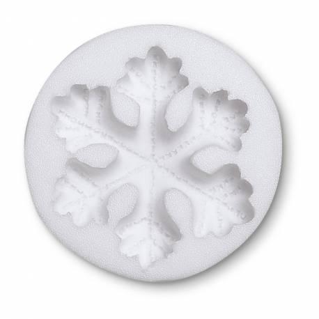 Moule modelage en forme de flocons en silicone. Vous pouvez vous en servir avec de la pâte à sucre, du chocolat, pâte d'amande, beurre,...