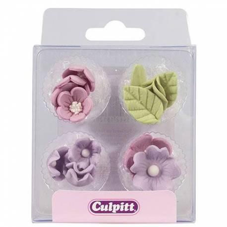 16 Mini décors en sucre fleurs lilas avec feuillespour décorer vos cupcakes, glaces, gâteaux, cakepops... Dimensions :1.5 cm x 2.5 cm