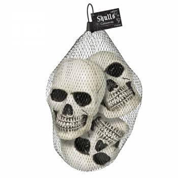 3 petites tête de mort en plastique