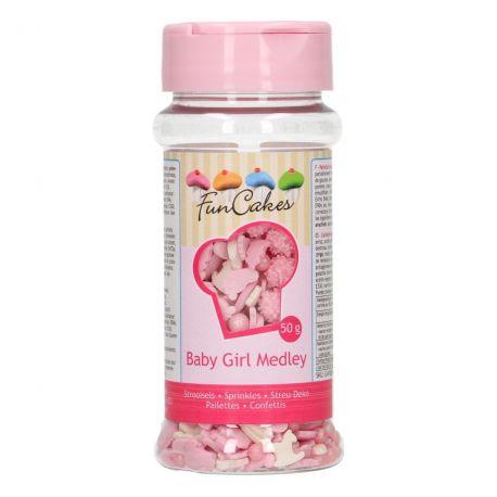 Décorez vos cupcakes, biscuits et autres douceurs maison grâce à ce medley de confettis en sucre bébé fille rose et blanc de FunCakes....