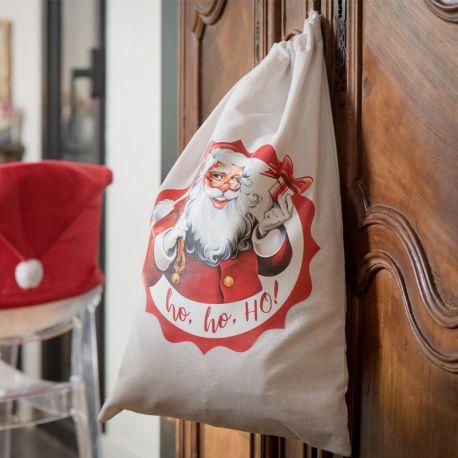 Sac à cadeaux en coton à l'effigie du Père Noël pour une belle décoration de pied de sapin de NoëlDimensions : 40 x 59cm