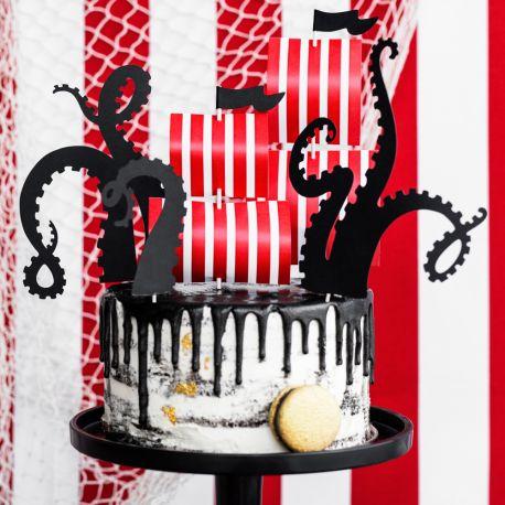 Kit pour réaliser la décoration d'un gâteau d'anniversaire sur le thème des pirates en 2 minutesContient 5 pics, 1 petite voilet et...