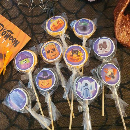 Assortiment de 10 sucettes foraines orange et noires à l'effigie de décors d'Halloween, idéal pour la distribution de confiseries le...