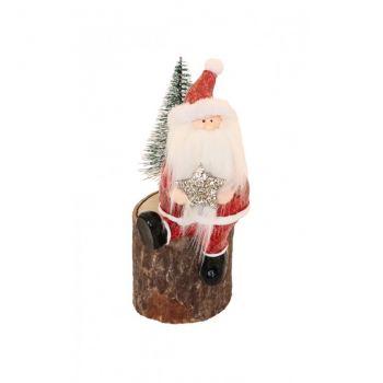 Père Noël sur tronc en bois